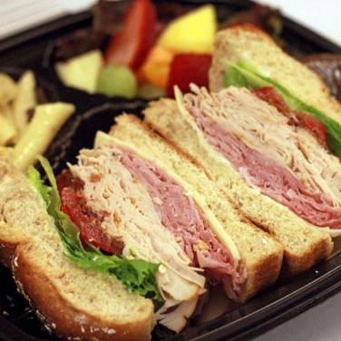 Club sandwich: swiss cheese, rosemary ham, bacon, smoked turkey, tomato, lettuce, mayonnaise on challah roll