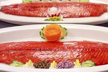 Smoked Salmon Presentation served with cucumber dill sauce, capers, red onion, lemon garnish